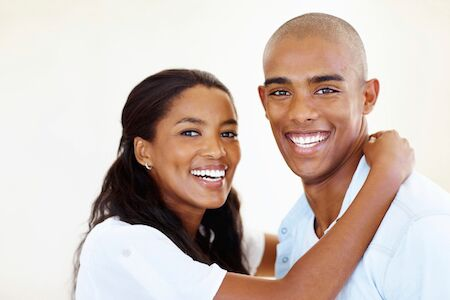 couple smiling after teeth cleaning